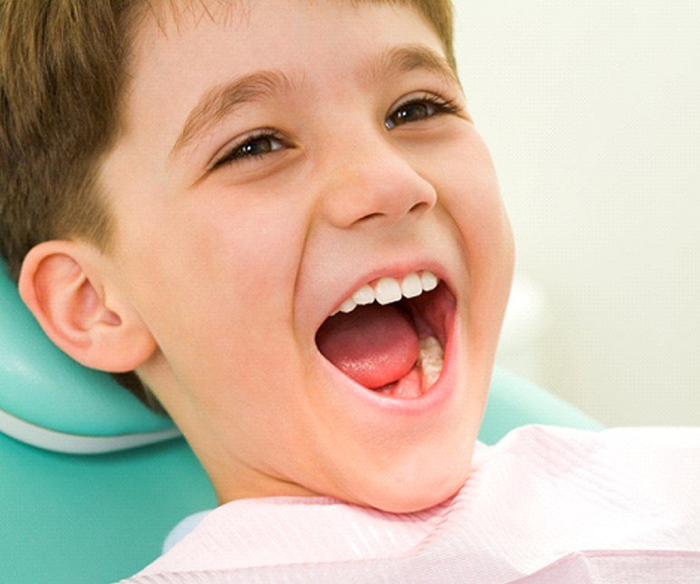 Young boy happy at child's dentist.