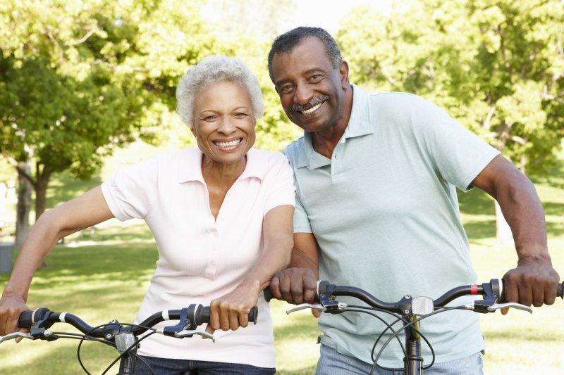Couple smiling outside